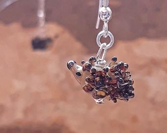 Tiny glass hedgehog earrings