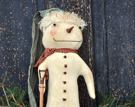Primitive Snowman with Shovel