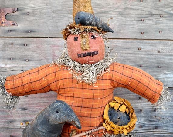 SALE! Primitive Scarecrow on Pumpkin