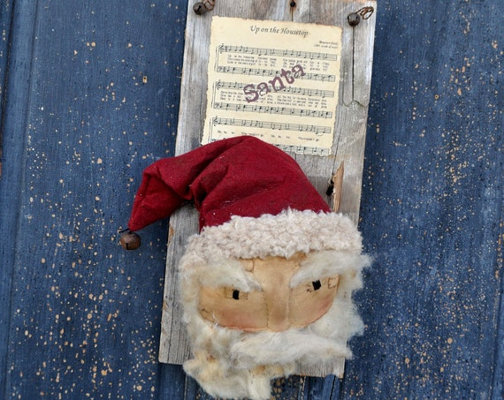 Primitive Santa on a Barnboard