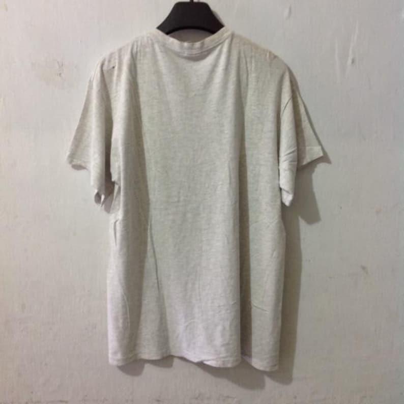 48e623917a0e1 Vintage NIKE silver tag X Looney Tunes shirt size XL