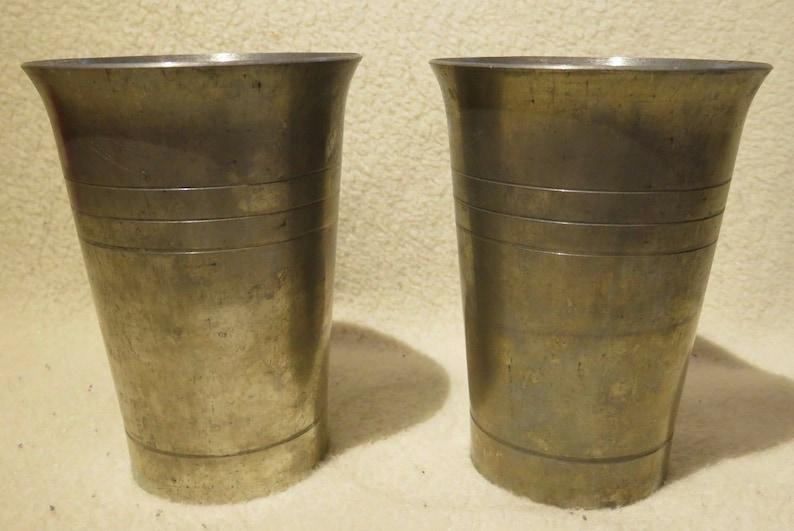 Set of 2 vintage pewter glasses from an antique shop.