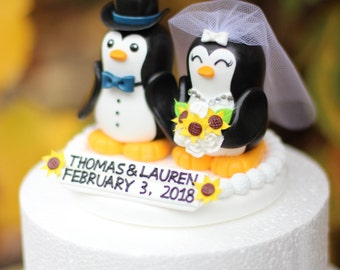 A penguin couple wedding cake topper / navy blue bow / sunflowers