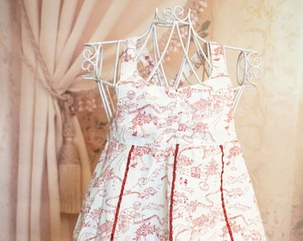 White summer dress with red toile pattern with matching bloomers