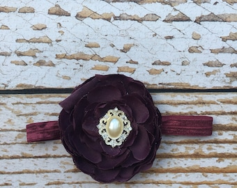 Maroon flower headband with pearl accent
