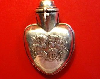 Vintage Silver Hinged Heart Locket with Cherubs
