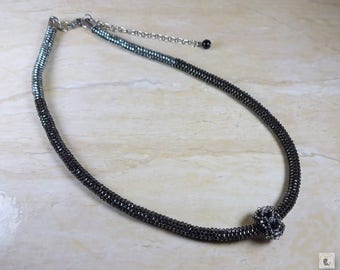 Black and silver beaded necklace with pendant. Necklace and earrings set (earrings are optionnal).