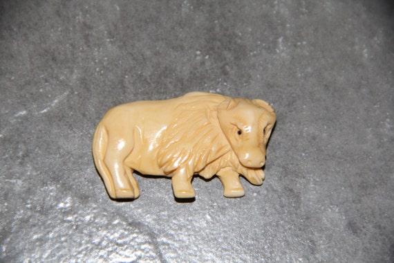 One Piece Buffalo Bone Carved Bull