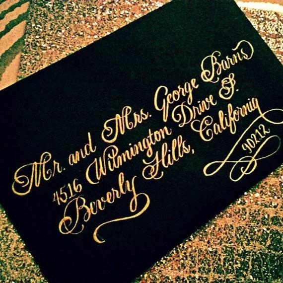 Gold on black envelope copperplate calligraphy script for weddings galas Fancy modern calligraphy envelopes celebrations holidays
