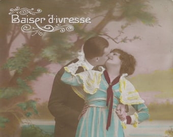 """Hand colored """"romantic"""" postcard of kissing couple"""