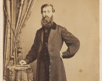 CDV of of well dressed bearded man in overcoat / carte de visite