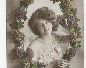 Hand colored photo postcard of pretty girl