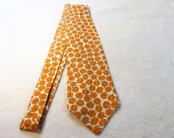 necktie made from fall pumpkins on off white cotton fabric, adult, teen, thanksgiving, Halloween, harvest, teacher, wedding, doctor, father