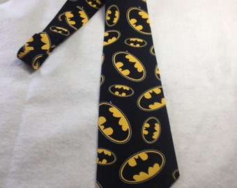 necktie or clip on tie made from superhero Batman Symbol black and yellow cotton fabric