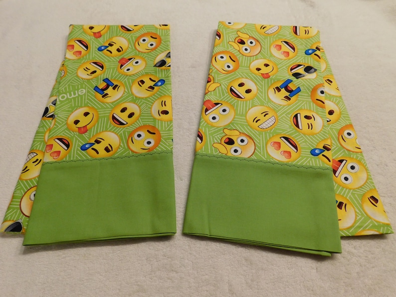 happy face smiley crying cool pillowcase made from Emoji on green cotton fabric with solid green cuff and black decorative stitching