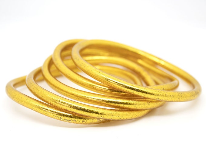 Gold Buddhist bracelets