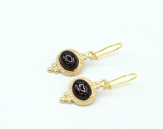 Earrings with a Garnet vintage style. sold per pair