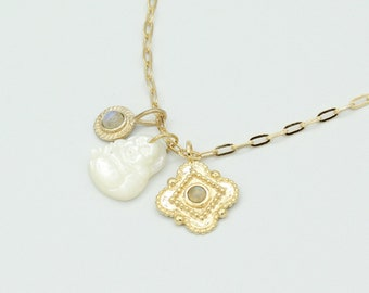 Necklace with charms including a mother-of-pearl Buddha