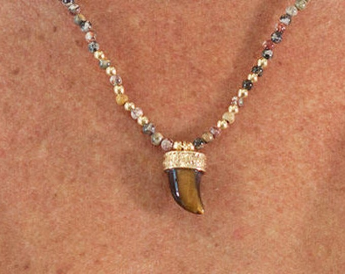 crew neck with a horn pendant and agate beads