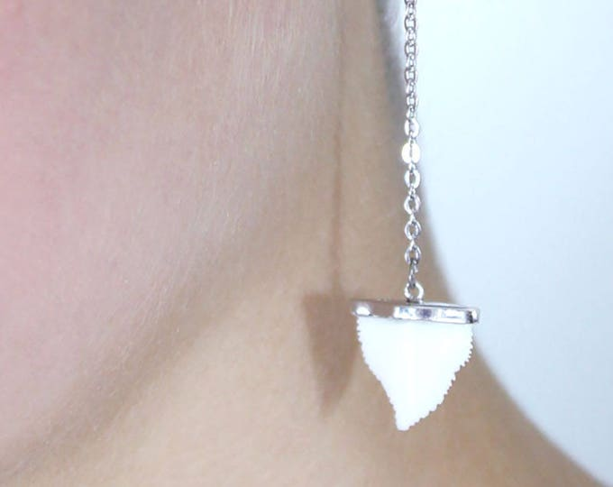earring with a shark tooth pendant