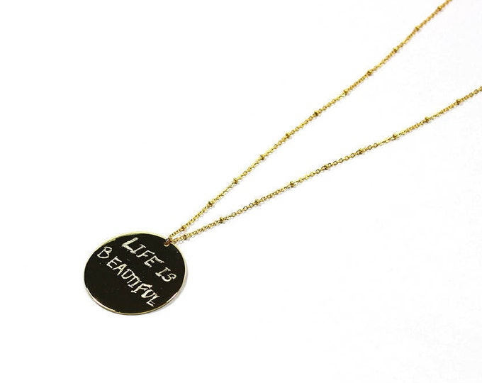 Necklace with a double-sided medal engraved