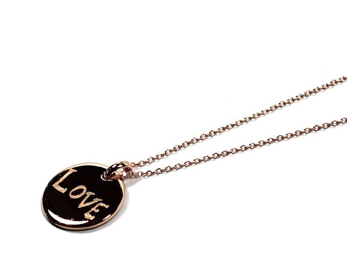 Necklace with a medal engraved LOVE