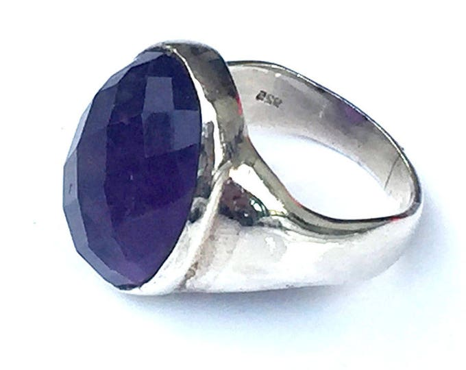 with a large Amethyst cabochon ring