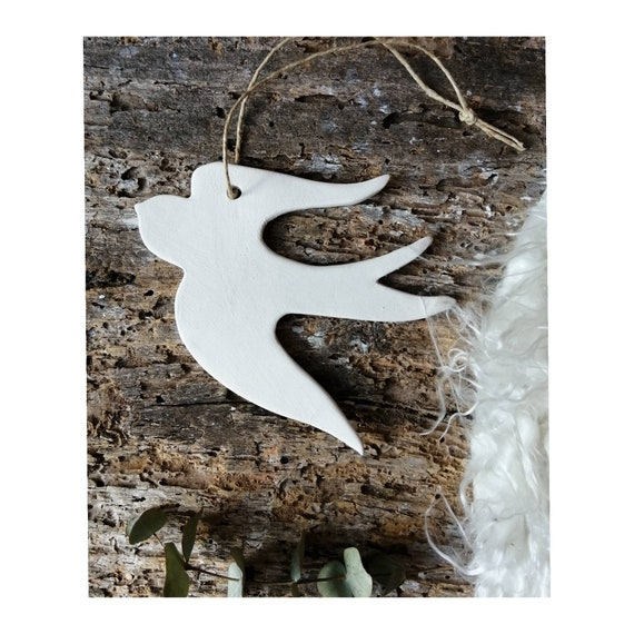 Minimalist raw white hanging ceramic swallow