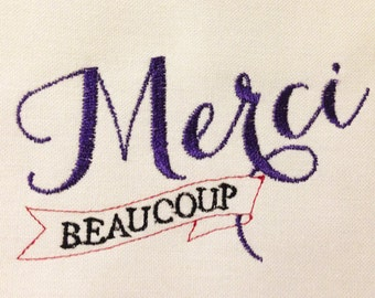 Elegant and whimsical merci beaucoup machine embroidery design in several sizes – a clever way to say thank you.