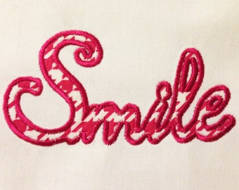 "The word ""smile"" machine embroidery design and appliqué designs in several sizes and styles"