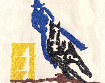 Cowboy on horse barrel racing machine embroidery design.