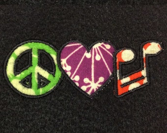 Peace, love and music machine applique design. Two different versions in three sizes.
