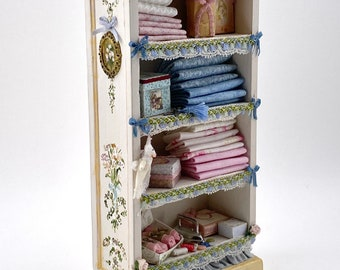 Shelf hand painted in ivory tone, sold with accessories as seen in the photo. Scale 1.12