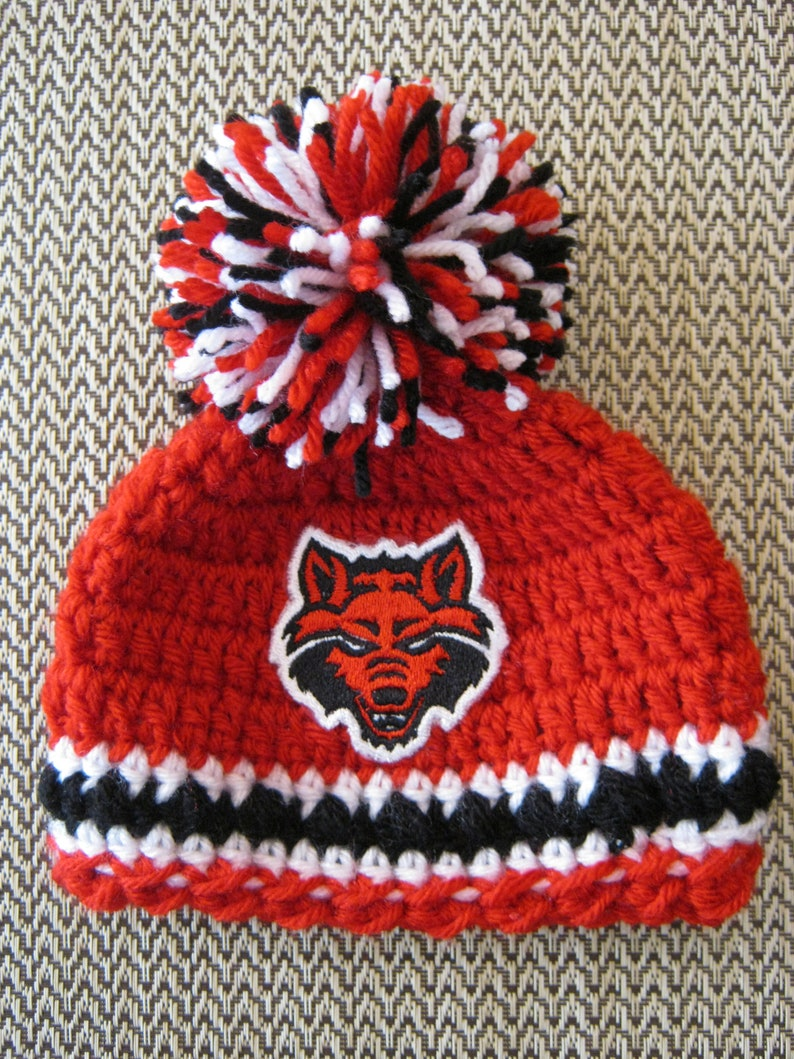 05be525e2 Crochet Beanie Baby Hat - Embroidered Logo (Arkansas State Red Wolves) Red,  Black, and White with Red Wolves logo and 1 large pom pom
