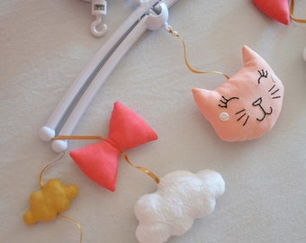 Mobile musical cat, knots, coral graphic cloud, pink, white, mustard