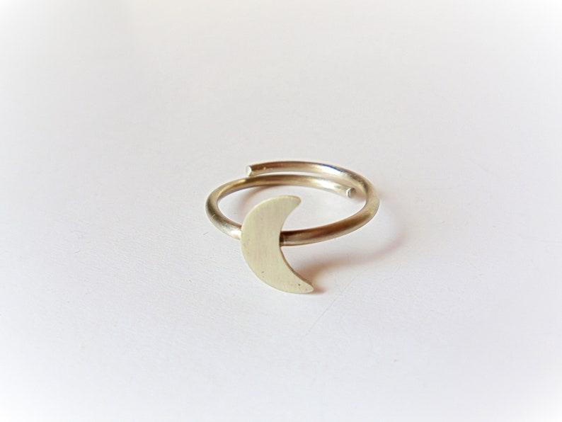 Silver half moon ring.