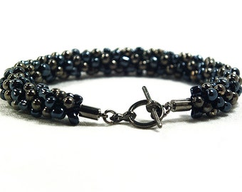 Black And Gunmetal Beaded Kumihimo Bracelet With Gunmetal Clasp