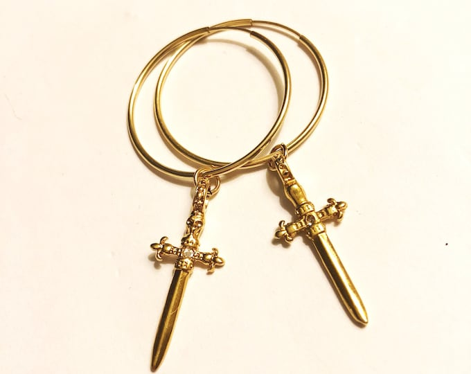 Cross and hoop earrings