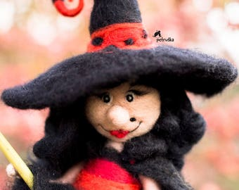 Halloween witch in red and black on a broomstick, halloween decoration, Petruska,