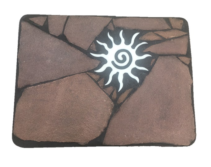 "Star Coffee Table: A 18"" x 24 1/2"" x 15"" tall natural stone folk art table featuring a southwest sun symbol"