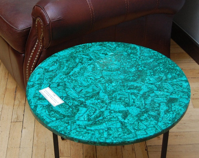"Congo: A 23 1/2"" diameter x 18"" tall folk art accent  table featuring a slab of composite malachite from the Congo."