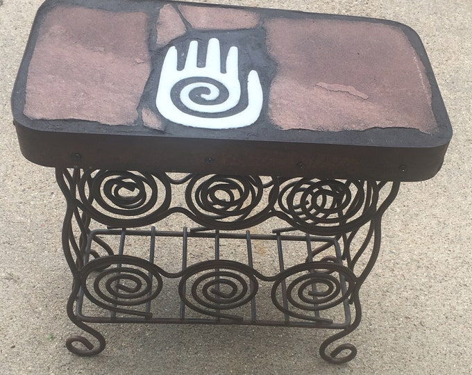 Hand Stand: a natural stone topped accent table featuring a Hopi hand symbol cut from pure marble.