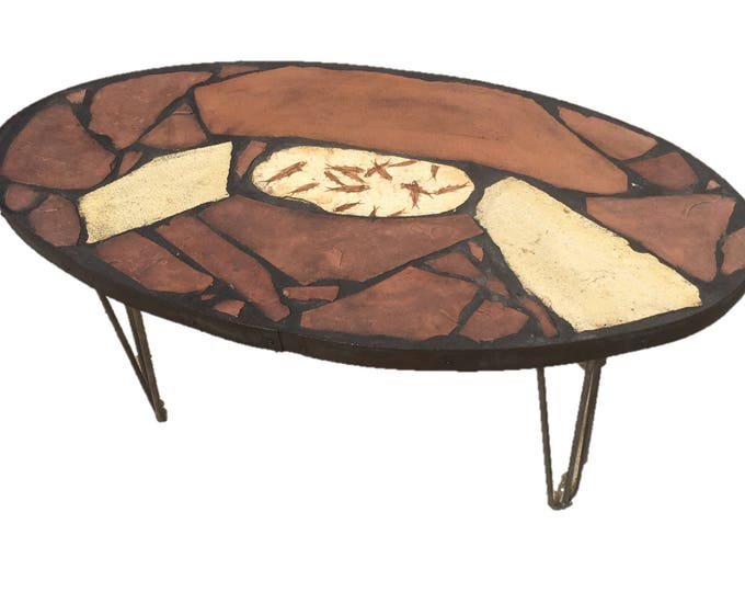 "Fishing Hole: A 40"" x 20"" x 18"" tall fossil stone topped folk art table."