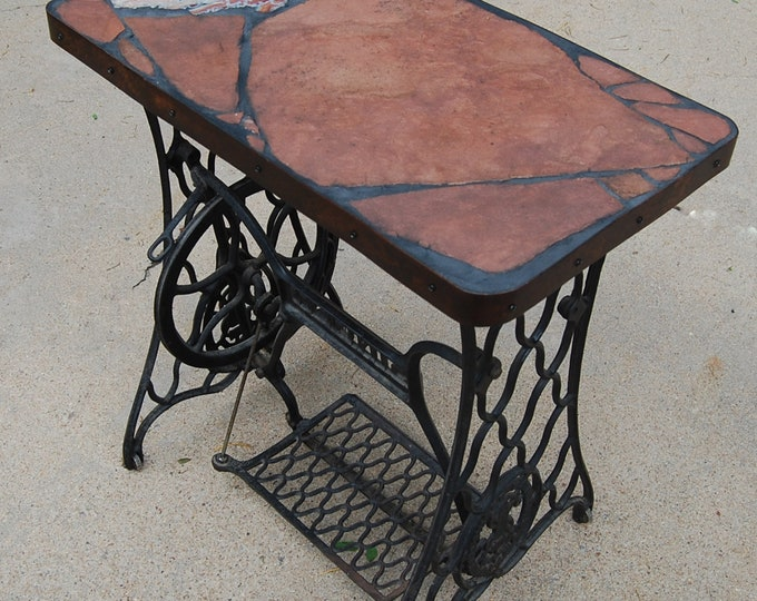 Singer 166: A natural stone topped table featuring a sewing machine base and a pretty rock with an ugly name
