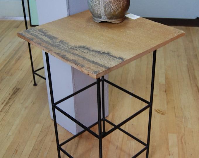 Tall Sandstone (Dark): A natural sandstone pedestal or bar table