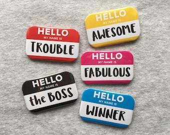 Hello name badges, pin back badges, flairs.