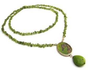 Necklace with miniature painting of a seahorse and peridot