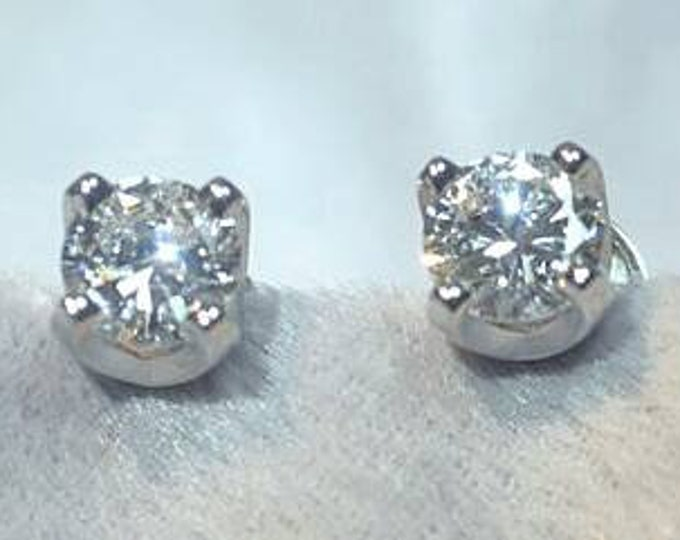 Pair of 14 Karat White Gold Diamond Earrings. Approximately 1.00 Carat Total Weight.
