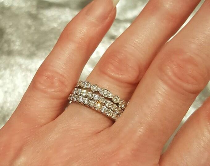 Two 14 Karat White Gold Matching Diamond Rings.