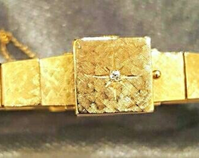 Hallmarked 14K Yellow Gold Beautiful Vintage Diamond Wristwatch with a Hinged Diamond set Cover.